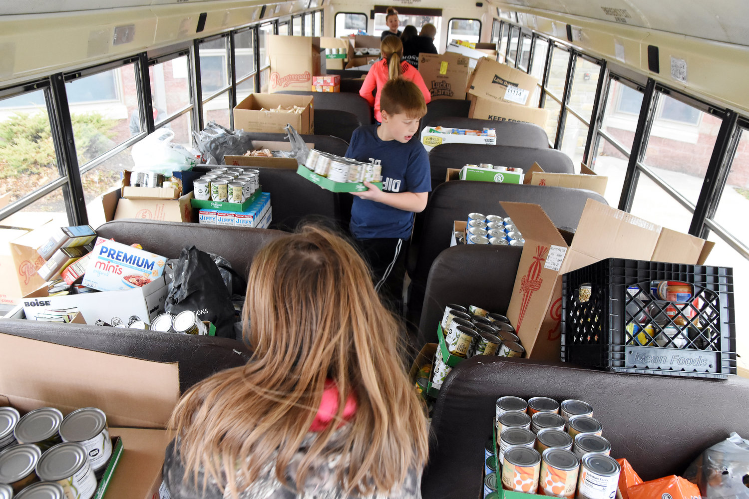 "Students stand inside a Gasconade R-2 District school bus with the ""Fill the Bus"" donations."