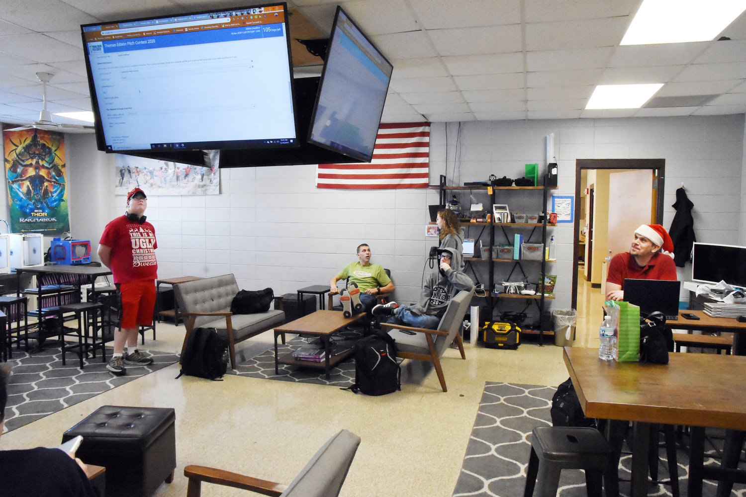 Owensville High School science teacher Kevin Lay looks at large-screen monitors in his classroom in December as students prepare a contest entry form. The school's 2018 entry into the Samsung Solve for Tomorrow competition won the national prize of $100,000 worth of technology and electronics equipment including these monitors. Equipment was shared between buildings in the district.