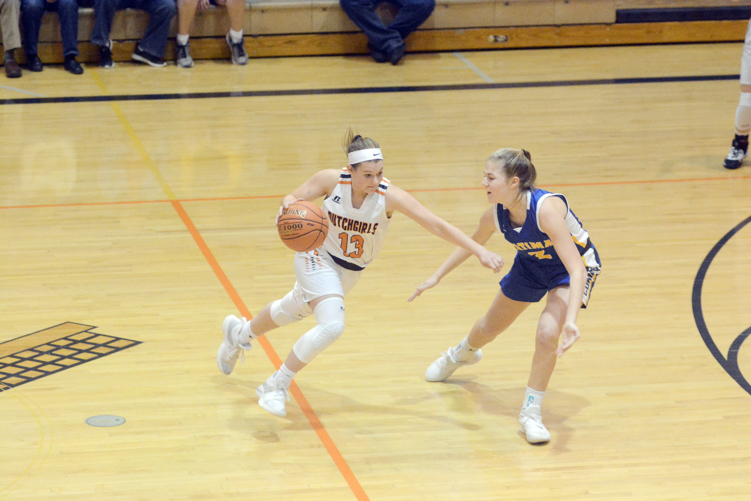 Katelyn Landolt (above, left) extends her arm to create separation between herself and Fatima's Dani Stegeman during Owensville's 52-30 loss last Thursday at Owensville High School. These two teams could meet again Friday in the Comet Classic Girls Basketball Tournament at Fatima High School in Westphalia.