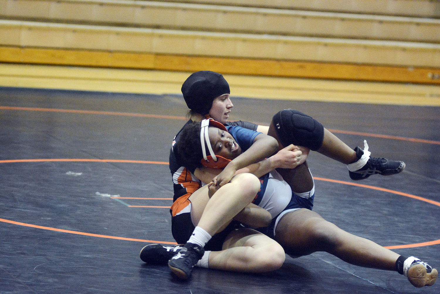 Emma Reed controls Central Park Hills wrestler Jasmine Alley during their exhibition wrestling match at 142 pounds.