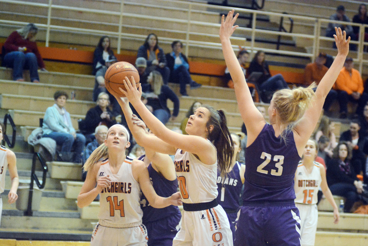 Keira Hendrix (above, center) gets fouled going up for a shot during Owensville's 54-30 victory in varsity action over Pacific's Lady Indians Thursday night in the final home game of the season for the Dutchgirls.