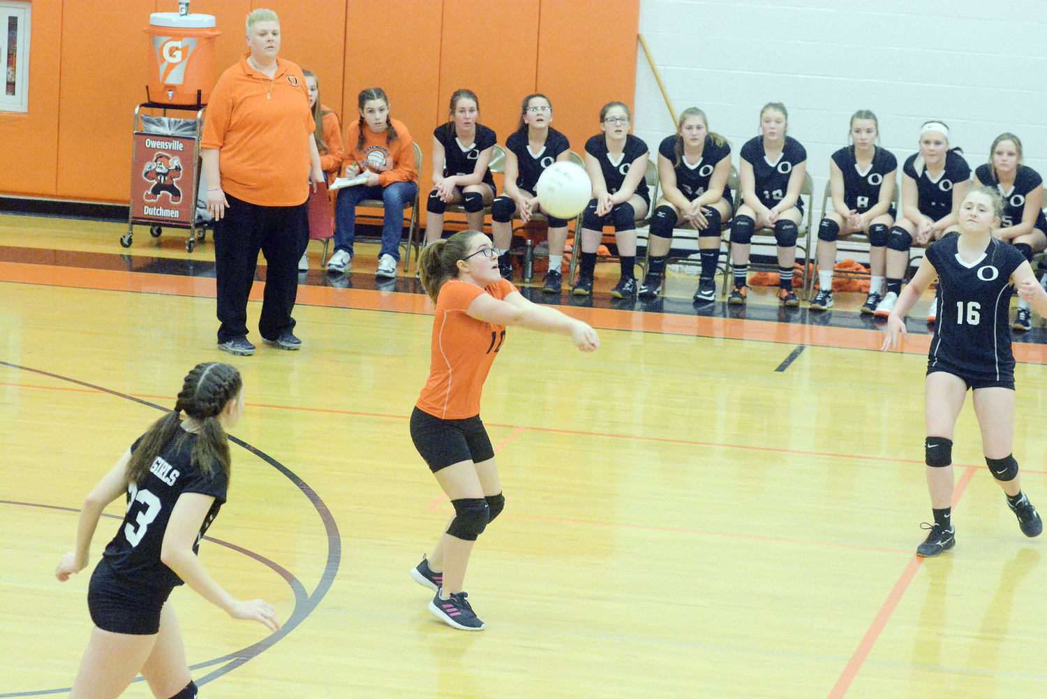 Kendra Lay (above, center) positions herself to bump the volleyball during Owensville's three-set victory last Thursday night against Bland's Lady Bears in Highway 28 middle school volleyball action at Owensville Elementary School.