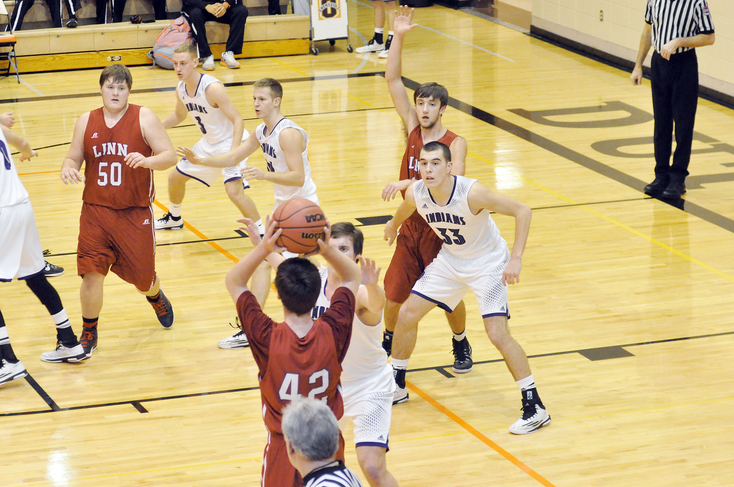 Cullen VanLeer (above, far right) establishes defensive position against Linn's Wildcats during the 2015 Owensville Tournament in which he won the last of his four Most Valuable Player (MVP) awards. In addition to being the lone four-time MVP during the 31-year history of the tournament, VanLeer is currently the tournament's all-time leading scorer with 271 points over four seasons. Along with VanLeer, former Sullivan Eagle basketball player Nathan Whittaker is the tournament's lone other player to make the All-Tournament Team four times.