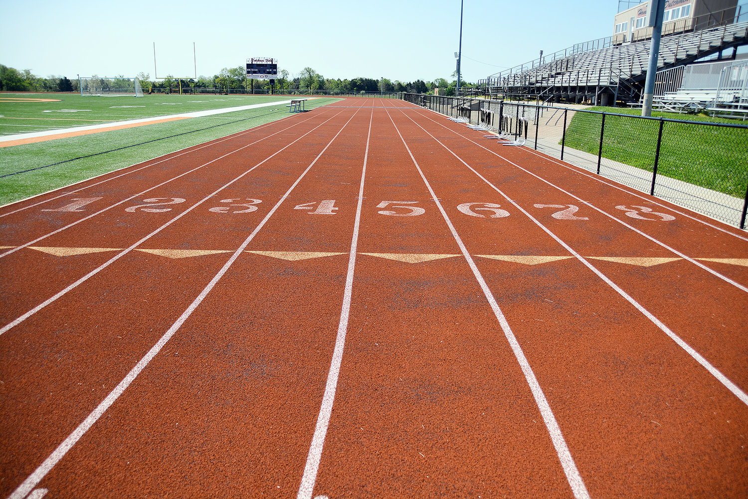 Black spots and fading numbers (above) are two of a number of indicators that it is time for the track at Owensville High School's Dutchmen Field to be resurfaced. In the above photograph taken Tuesday morning, there are several spots on the track where black is showing