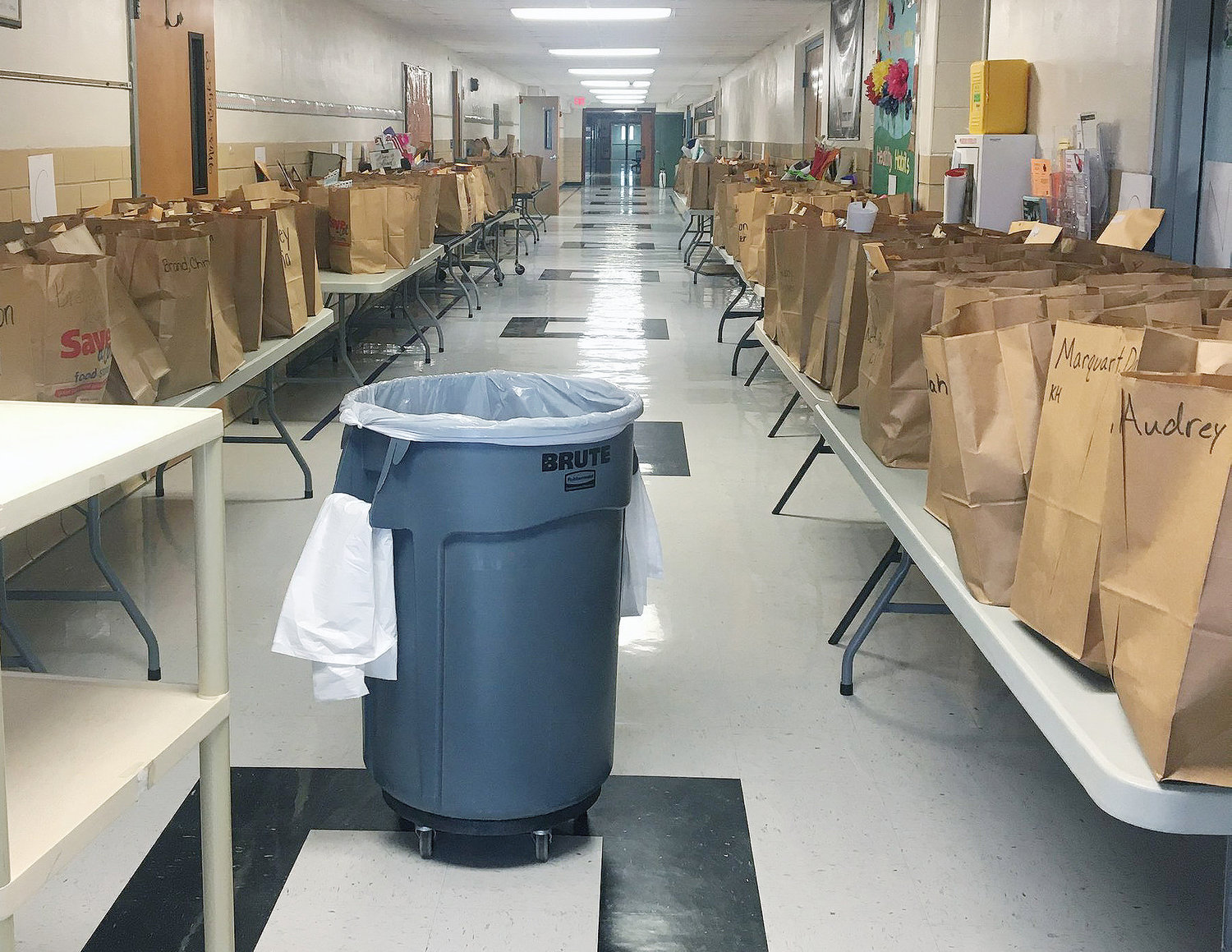 Carefully labeled bags filled with lessons, library books and the personal contents of student's desks lined the hallway at Gerald Elementary School Monday.