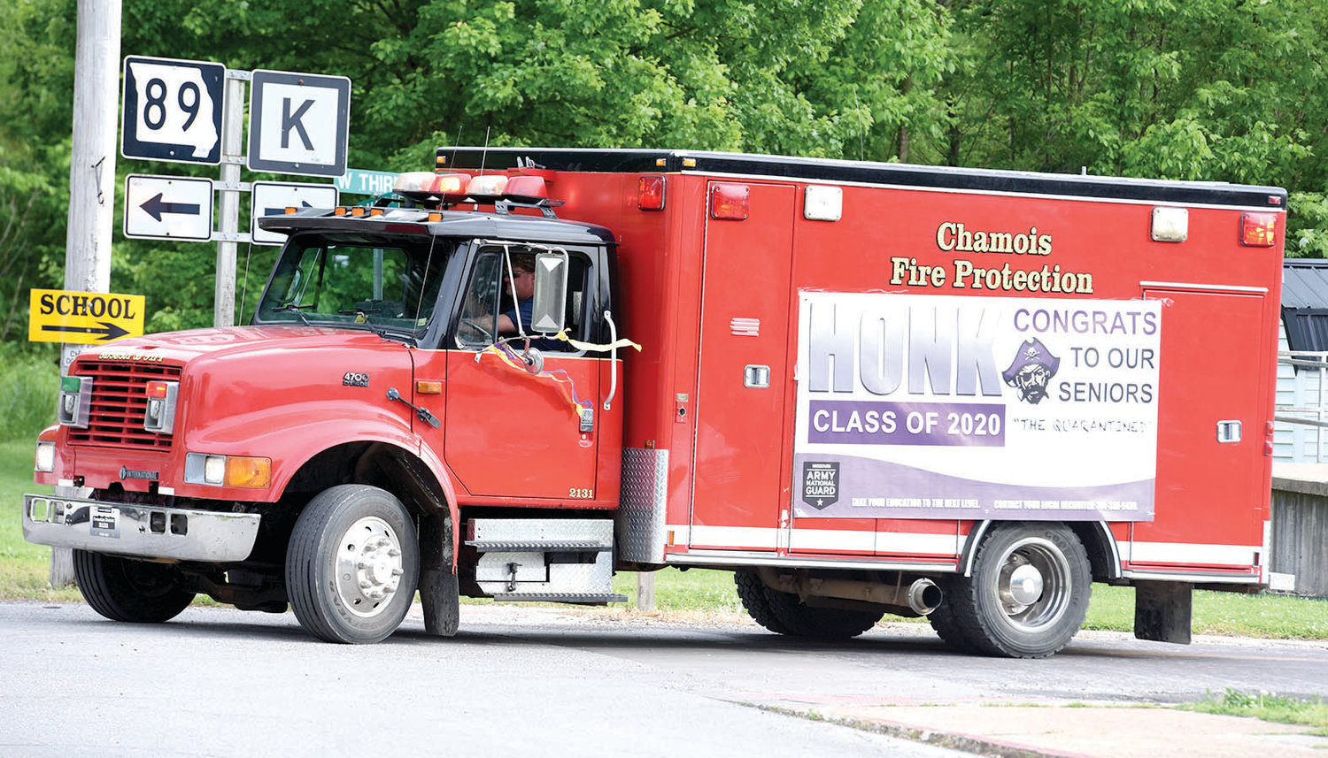 Members of the Chamois Fire Protection District were part of Friday's graduation parade at Chamois.