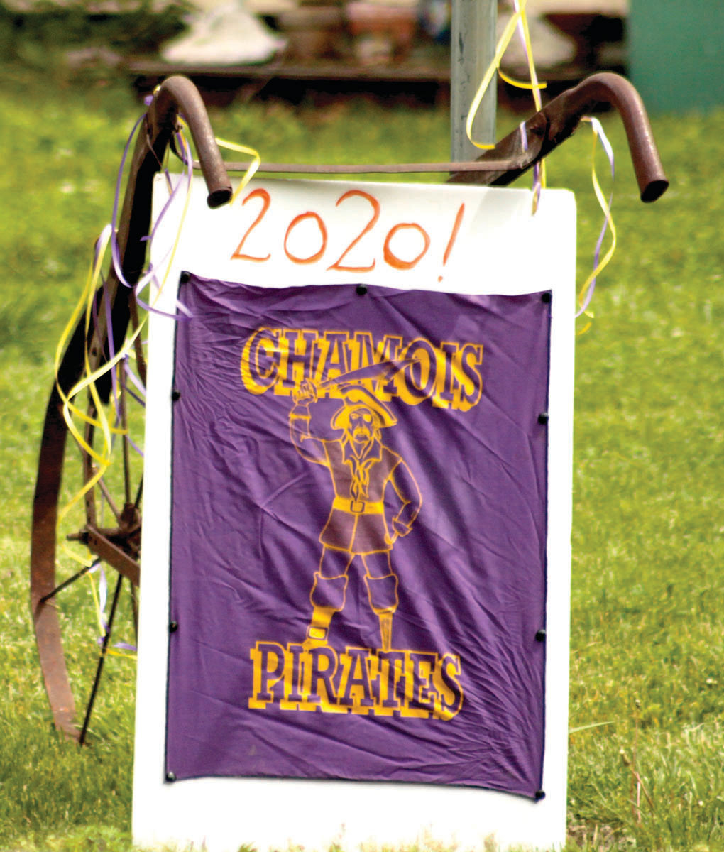 A sign in support of 2020 Chamois graduates is seen along the route taken Friday.