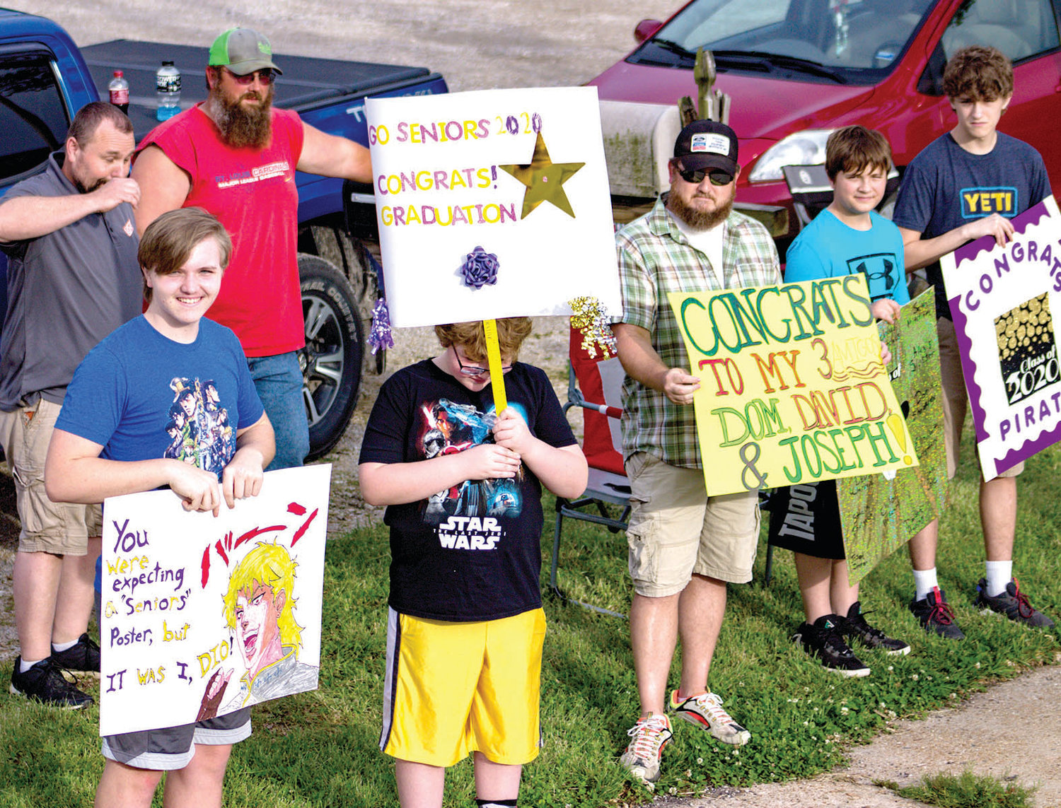 Signs and smiles were the theme as Chamois graduates took part in a parade on Friday.