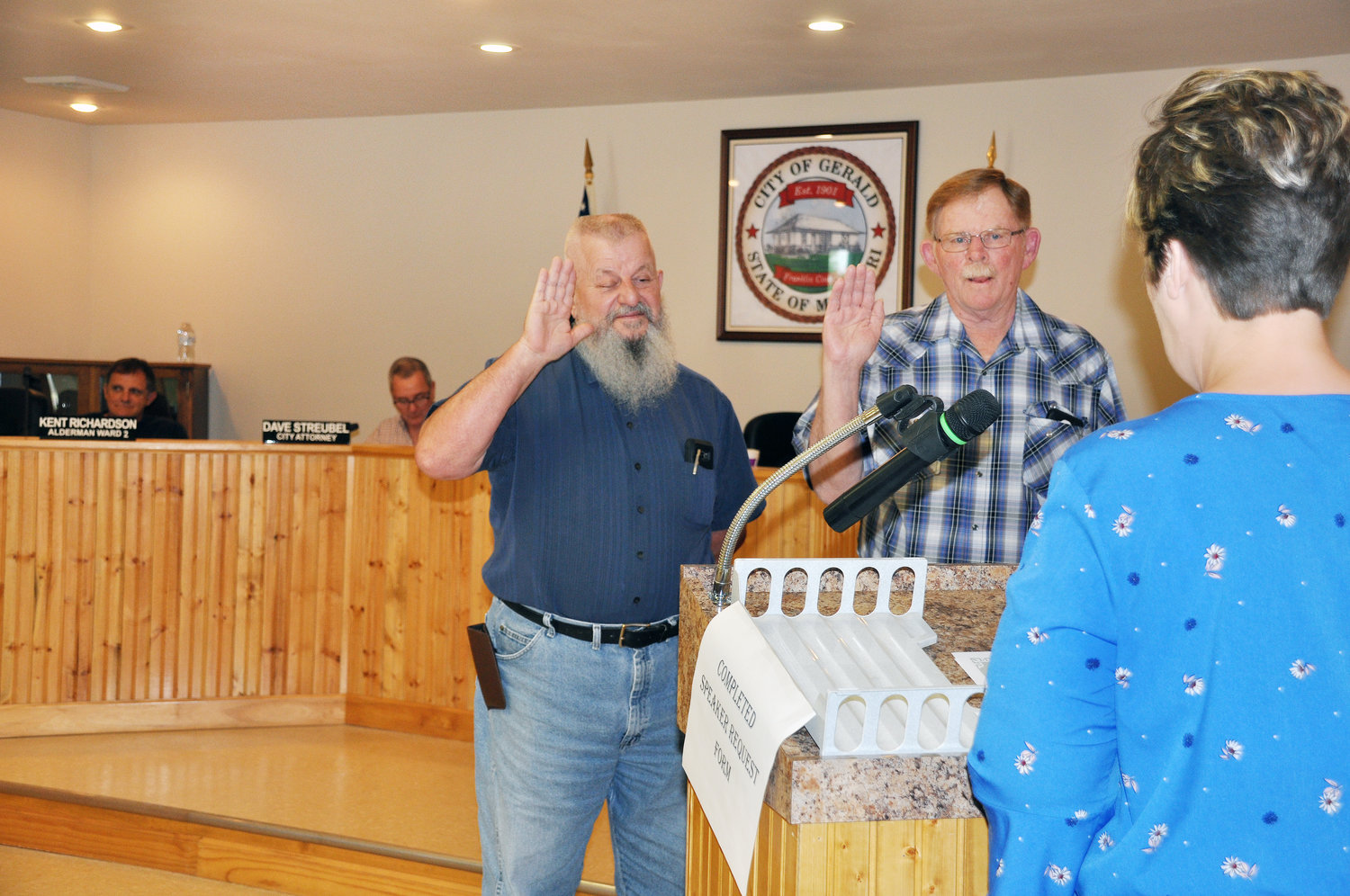 Interim City Clerk Be Ahring swears in Ward 1 Alderman Steve Grgurich and Ed Adams (left to right) at least week's re-organizational meeting of the Gerald Board of Aldermen. Ward 2 Alderman Kent Richardson and city attorney Dave Struebel look on.