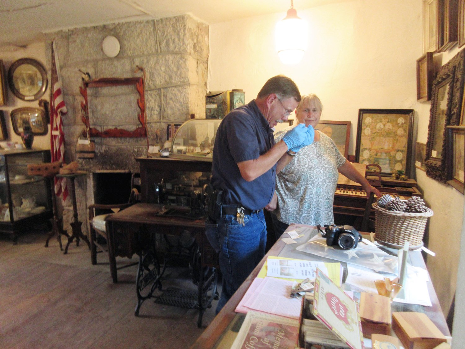 Vienna Police Chief Shannon Thompson is pictured speaking to Gail Howard as he investigated the break-in and theft at the Old Jail Museum in Vienna, which occurred last Tuesday night.