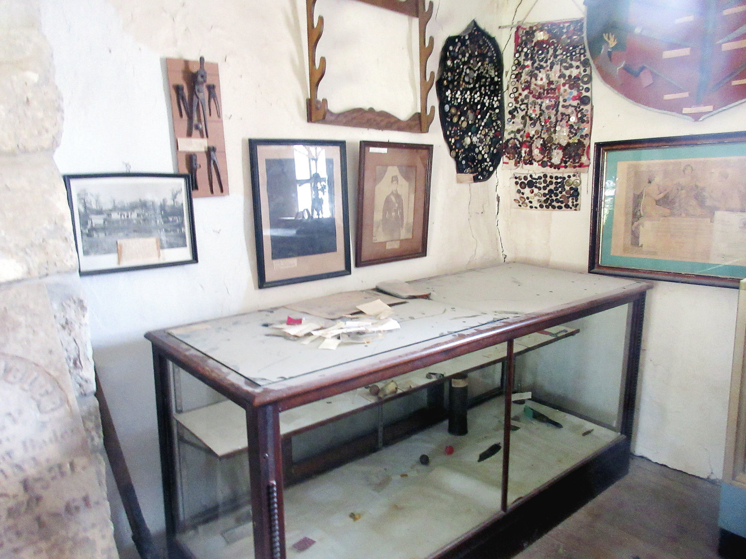 AN EMPTY gun rack and exhibit case once displayed antique weaponry and Indian artifacts of Maries County. The items were donated in memory of loved ones and stolen last week.