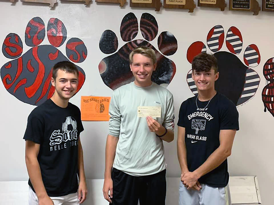 BHS students Aiden Craigmiles, Brayden Tipton, and Lane Feeler accept a check on behalf of the Maries R-2 School District for $50,000 front eh Party Family Heritage Trust to purchase new Chromebooks.