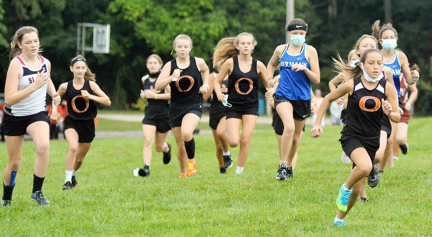 Ilene Limberg (far right) got a good start to move towards the front of the pack Saturday morning during the New Haven Cross Country Invitational at New Haven City Park. Limberg went on to pass Union's Viola Johanson halfway through the race going on to win it.