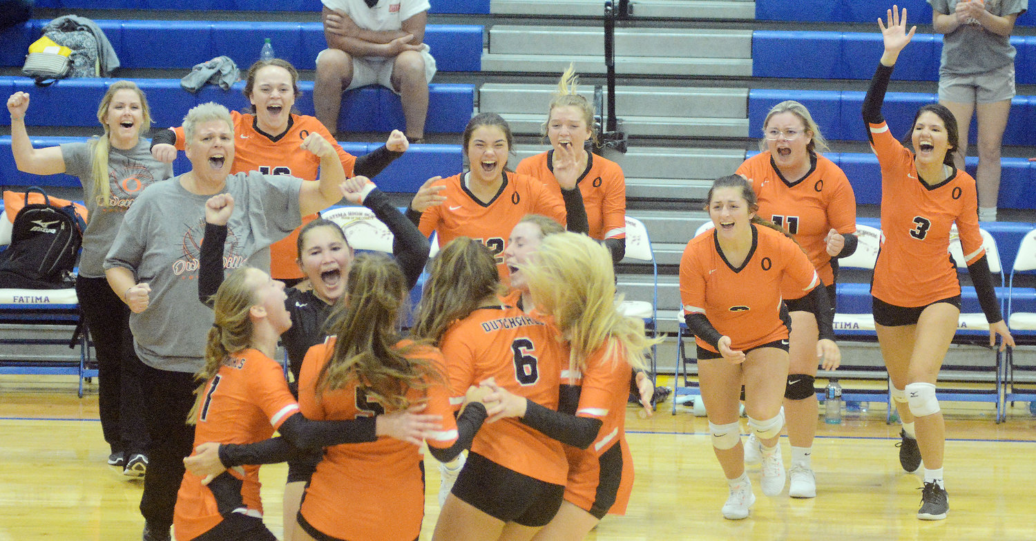 Varsity Dutchgirl volleyball team members (above) celebrate their five-set come-from-behind victory Thursday night on the road in Westphalia against Fatima's Lady Comets 21-25, 20-25, 25-22, 25-22 and 15-7. Owensville will host Sullivan Thursday in a match with huge Four Rivers Conference and district implications on the line.