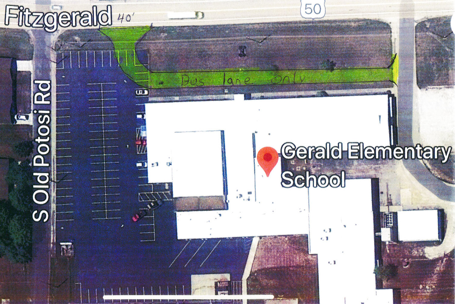 A HAND-LETTERED diagram of the Gerald Elementary School site shows the proposed bus road (in green) which Gasconade County R-2 School District Board of Education members are considering as part of their capital projects list. The small white block (lower, right) is the old bus barn building on the property's east side.