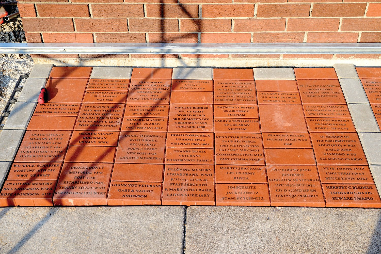A project launched in June by members of the Veterans of Foreign Wars Post 4756 in Linn came to fruition last weekend with the laying of 102 engraved and some blank bricks covering 15 feet along the east wall o