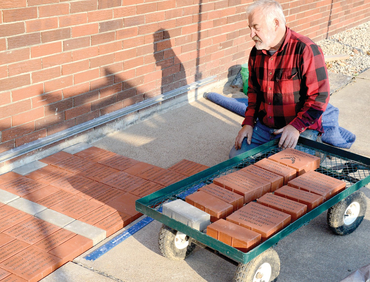 ike Jacquin led the project to install 102 engraved bricks at the VFW Hall in Linn.