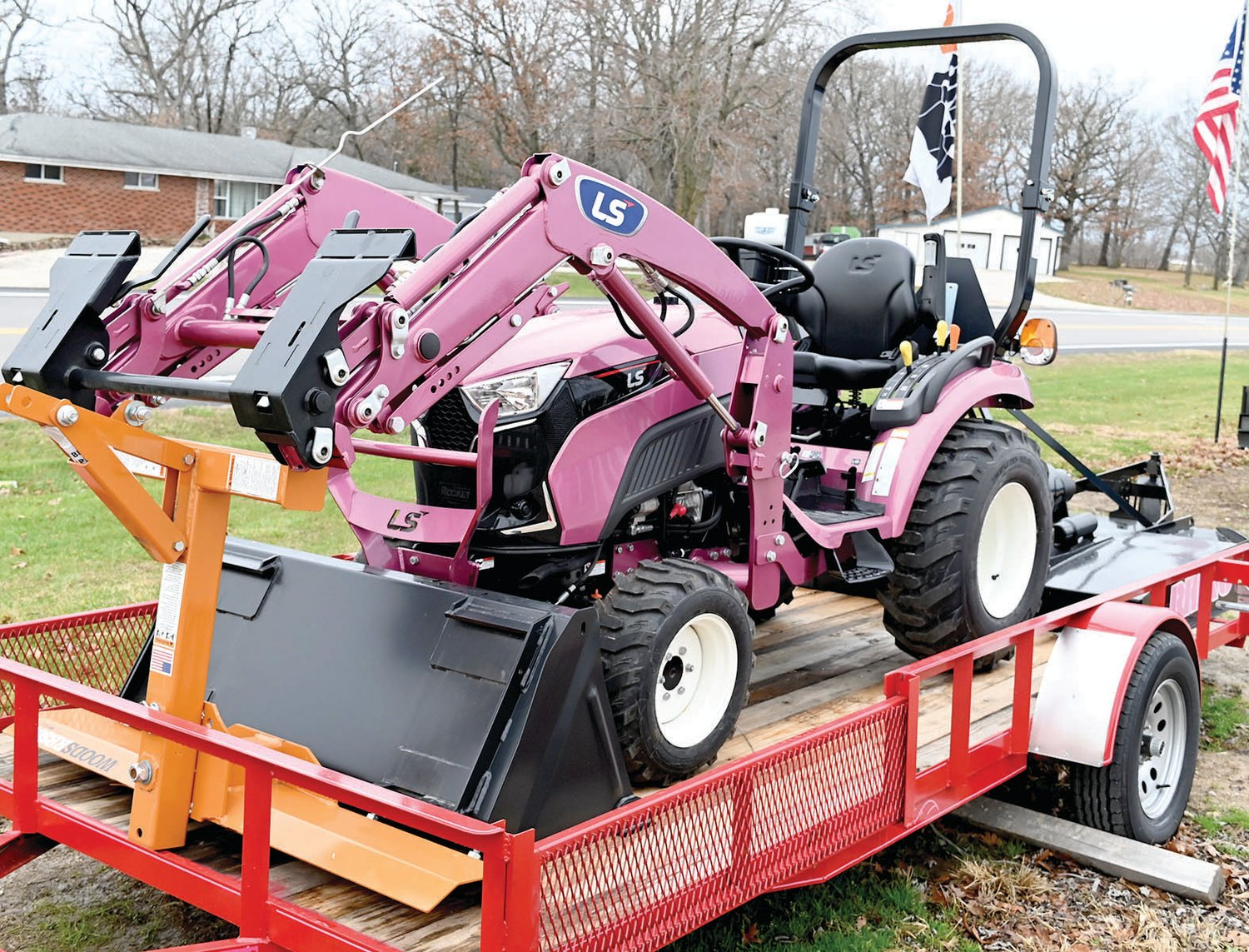 This pink LS MT225s, a25hp, Hydrostat four-wheel-drive tractor is being sold by Diamond R Equipment in Westphalia to raise funds for the Community Breast Care Project based in Jefferson City.