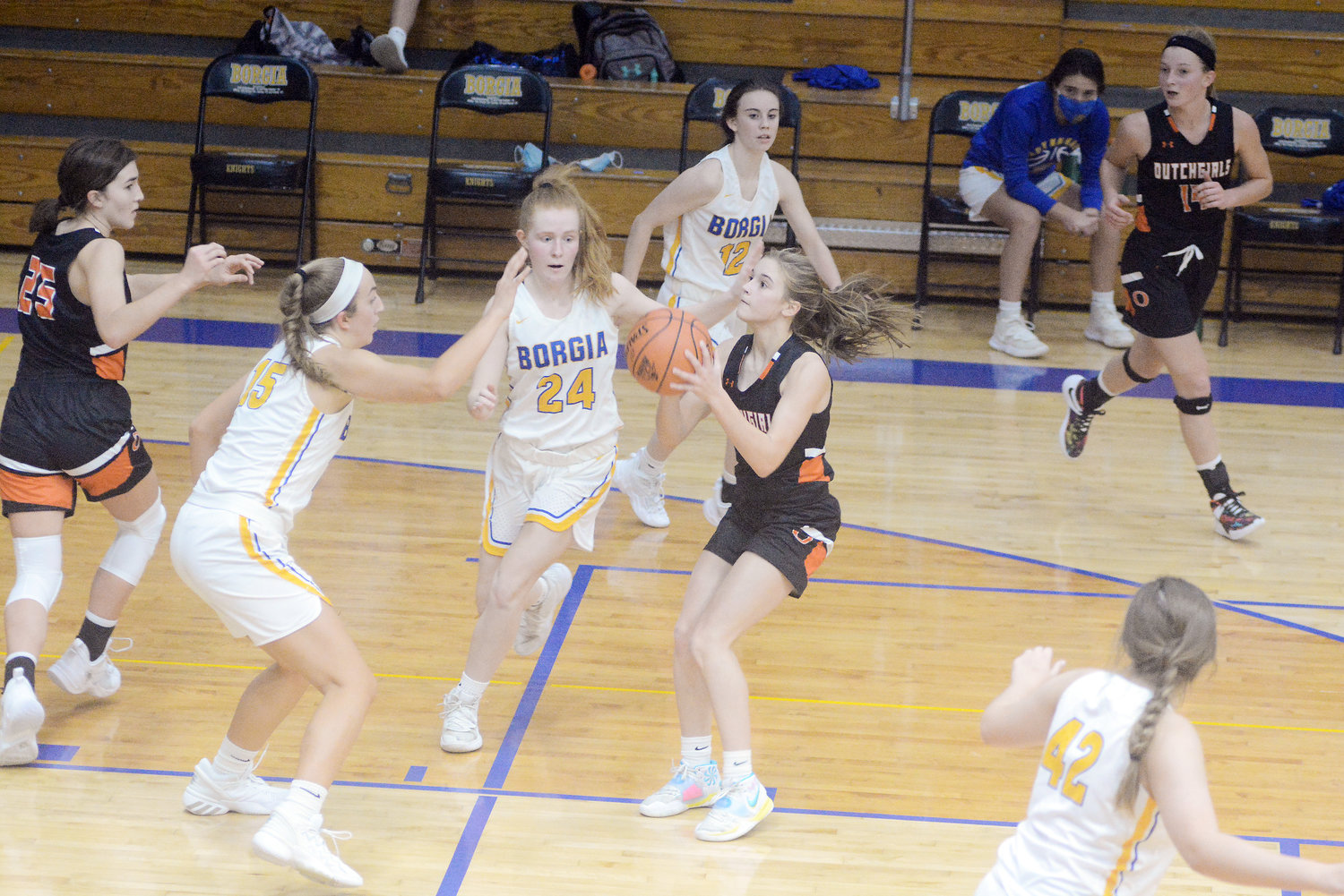 Emma Daniels (center) prepares to take a shot in the paint for Owensville during their season-opening 71-55 victory Monday night on the road over the St. Francis Borgia Lady Knights. Dutchgirl teammates also shown on offense were Anna Skornia (far left) and Anna Finley (far right).
