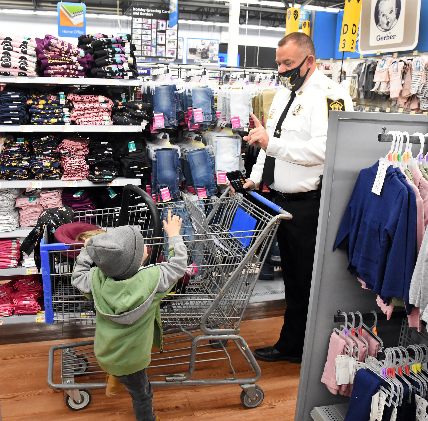 Sheriff-elect Scott Eiler reminds a young boy he needs to pick out one clothing item.