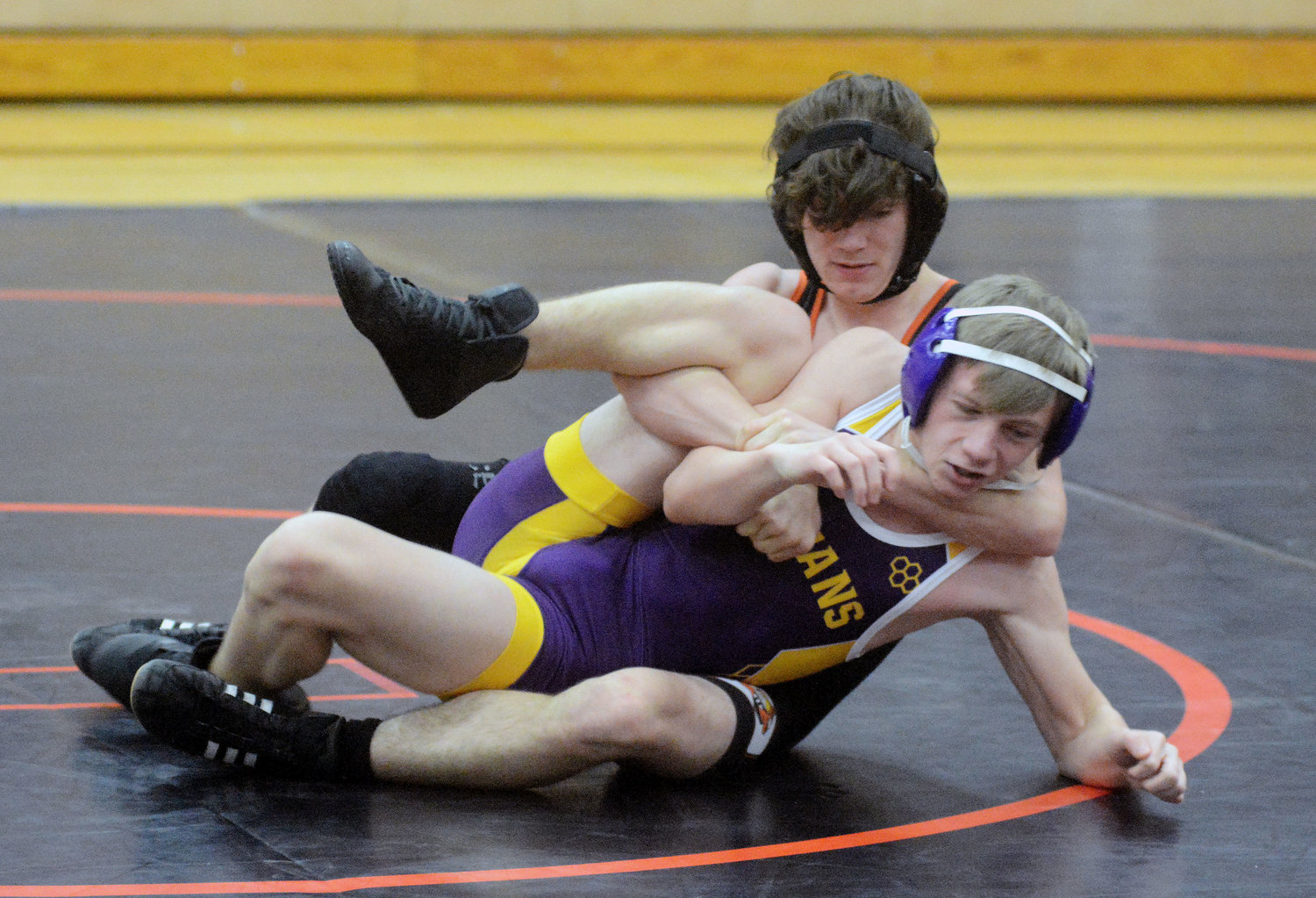 Aries Nicholas (above, behind), looks to work his Potosi Trojan opponent's back to the mat during Owensville's season-opening triangular meet back on Friday, Dec. 4 against the Trojans and Sullivan's Eagles.